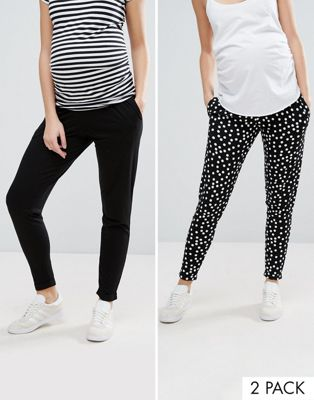 ASOS DESIGN Maternity 2 pack jersey peg trousers in plain black and spot print save 25%