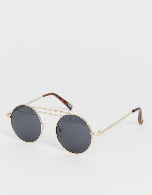 1d5fa7860a32 Image 1 of ASOS DESIGN metal round sunglasses in gold with smoke lens and  brow detail