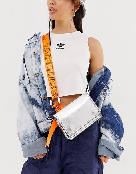ASOS DESIGN metallic sling bag with neon sports strap