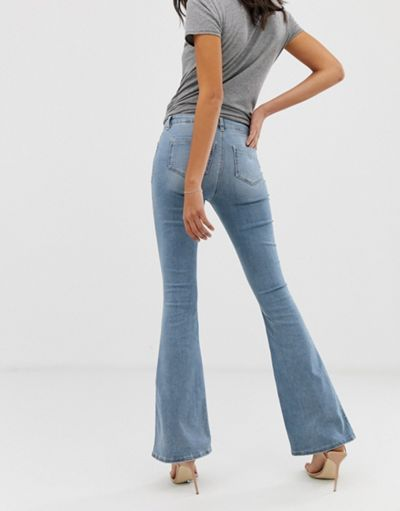 ASOS DESIGN Mid rise flare jeans in light wash blue