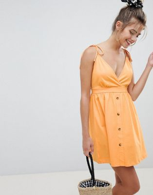 ASOS DESIGN mini tie strap button through sundress