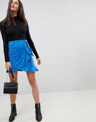 ASOS DESIGN mini wrap skirt in polka dot print
