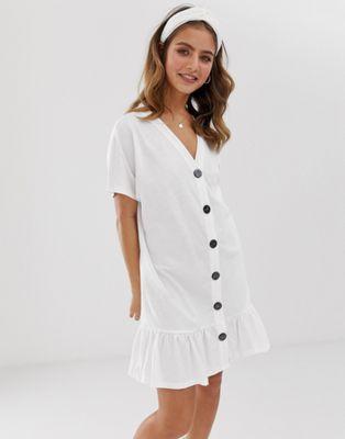 Bild 1 av ASOS DESIGN – Miniklänning med knappar och peplum