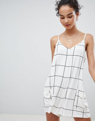 Image 1 of ASOS DESIGN minimal playsuit with pockets in white check print