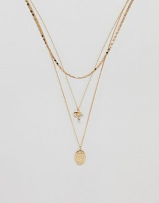 ASOS DESIGN multirow necklace with mixed chains and vintage style charms in gold