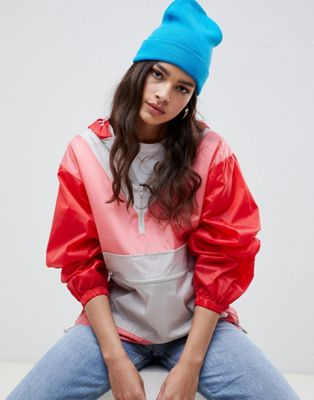 ASOS DESIGN over the head rainmac in colourblock