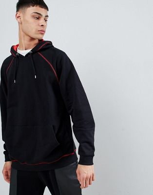 ASOS DESIGN oversized hoodie in red with contrast stitching