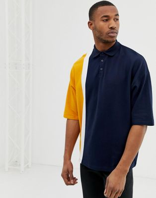 ASOS DESIGN oversized polo shirt in pique fabric with vertical colour block in navy