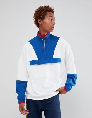 ASOS DESIGN oversized sweatshirt with half zip and map pocket