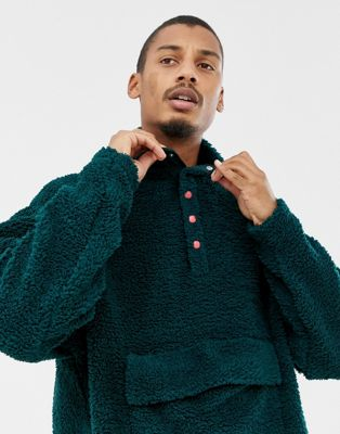 Image 1 of ASOS DESIGN oversized sweatshirt with popper neck in borg green