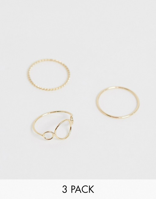 ASOS DESIGN pack of 3 rings with open circle design and twist band in gold tone