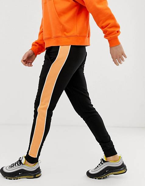0dcc177a4ec ASOS DESIGN - Pantalon de jogging ajusté avec bande orange sur le côté -  Noir