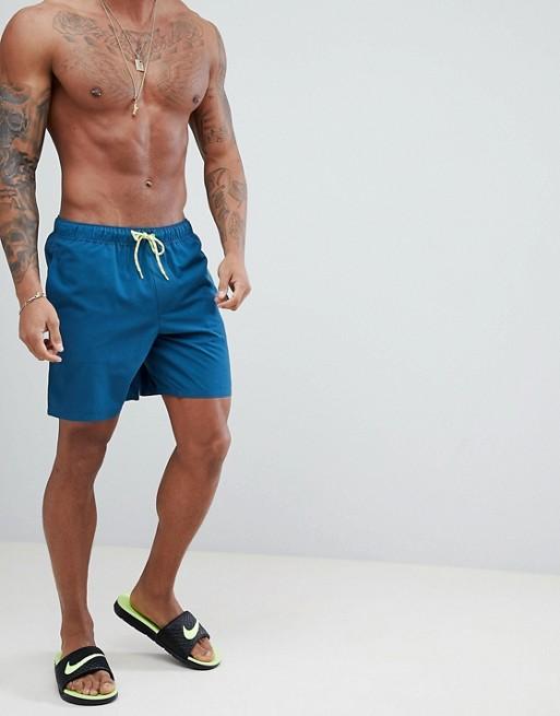 Immagine 1 di ASOS DESIGN - Pantaloncini da bagno blu con coulisse fluo lunghezza media