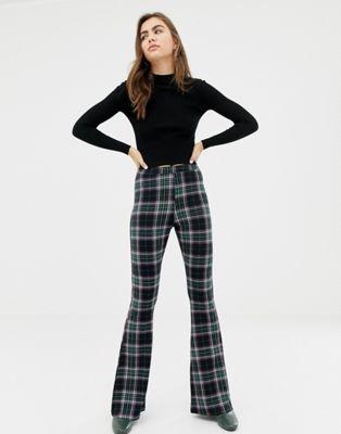 ASOS DESIGN - Pantaloni a zampa a quadri