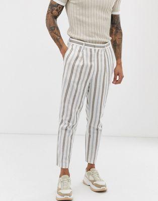Immagine 1 di ASOS DESIGN - Pantaloni eleganti tapered cropped in misto lino bianchi a righe