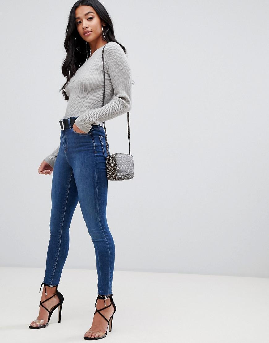 Asos Design Petite Ridley High Waist Skinny Jeans In Dark Stone Wash With Raw Hem Detail by Asos Design