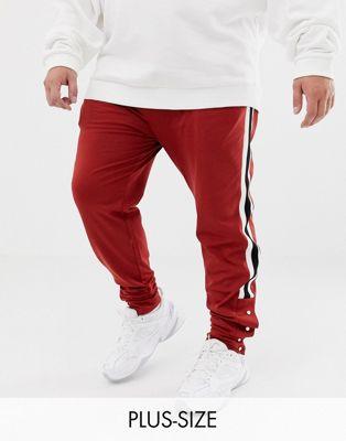 ASOS DESIGN Plus - Pantalon de jogging ajusté rétro color block avec rayures et boutons-pression sur le côté