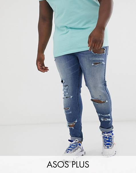 ASOS DESIGN Plus spray on jeans in power stretch with heavy rips in mid wash blue