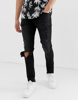 Image 1 of ASOS DESIGN recycled super skinny jeans in washed black with heavy rips