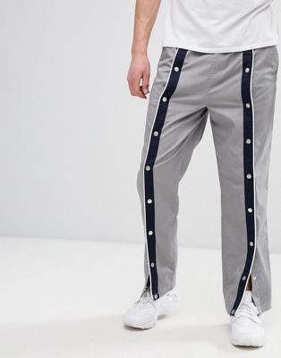 Image 1 of ASOS DESIGN relaxed pants in grey with front poppers