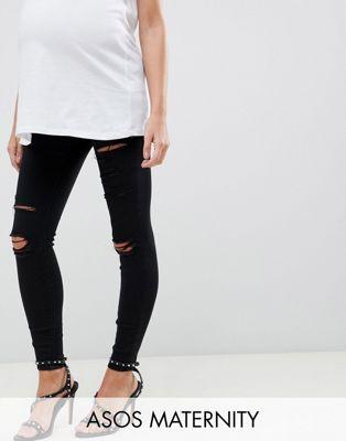 ASOS DESIGN - Ridley - Jeans premaman skinny vita alta neri con strappi e fascia sotto il pancione