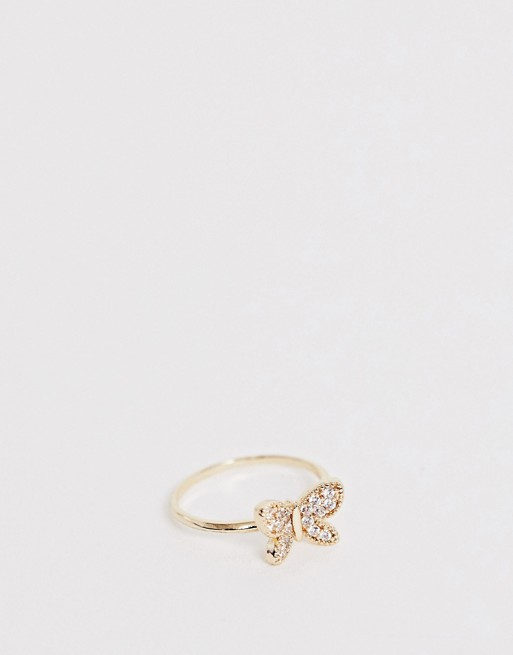 Image 1 of ASOS DESIGN ring with tiny crystal butterfly in gold tone