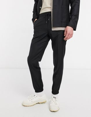 ASOS DESIGN – Schmal geschnittene Jogginghose aus 100 % Wolle in Schwarz