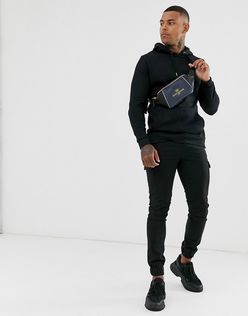 ASOS DESIGN – Schwarzer, lang geschnittener Kapuzenpullover aus Bio-Baumwolle | Bekleidung > Pullover > Kapuzenpullover | ASOS DESIGN