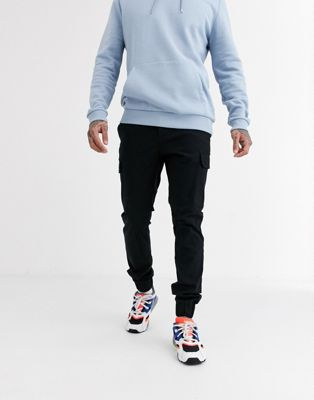 AAPE By A Bathing Ape casual nylon trousers with side zips in black - ASOS Price Checker