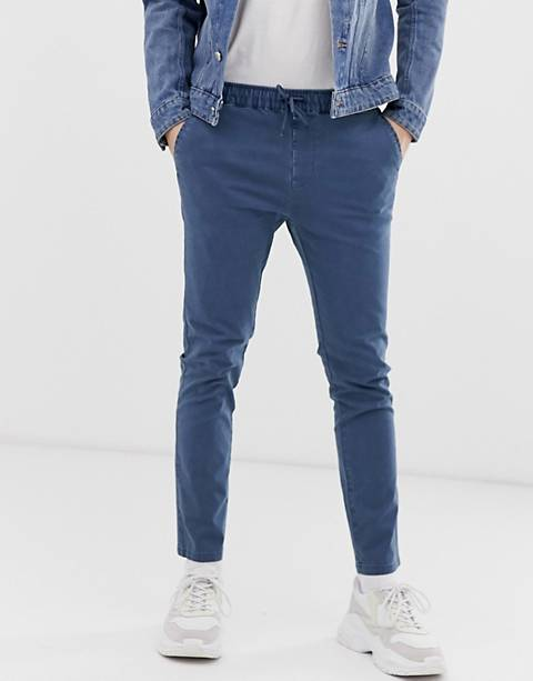 ASOS DESIGN skinny chinos with elastic waist in washed blue