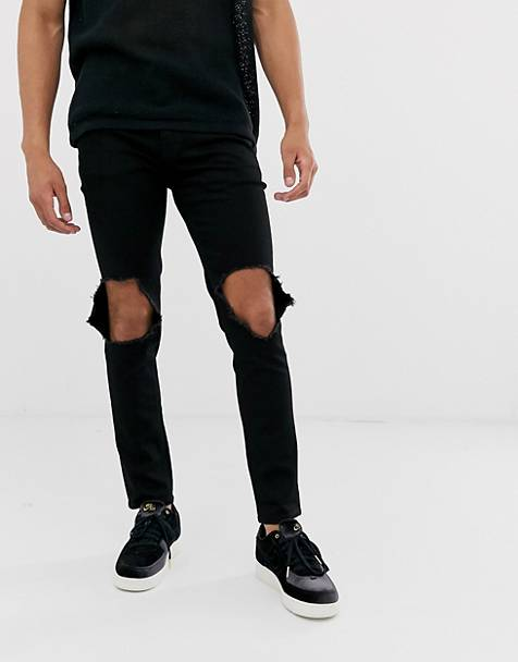 ASOS DESIGN skinny jeans in black with open knee rips