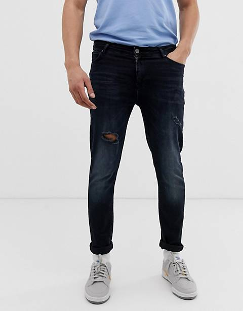 ASOS DESIGN skinny jeans in blue black with abrasions