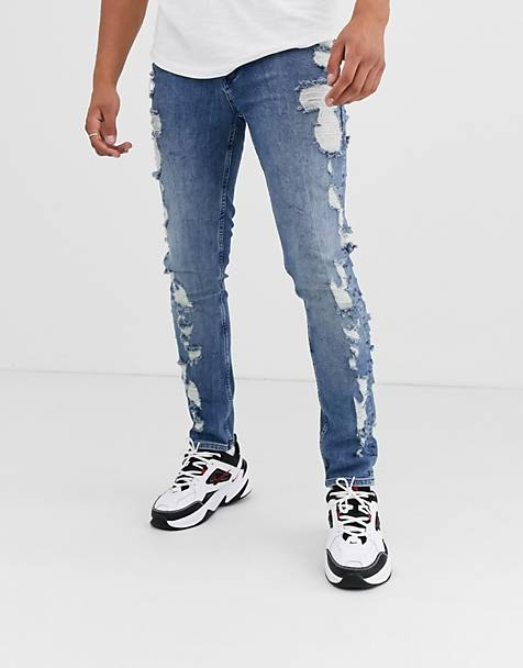 ASOS DESIGN skinny jeans in mid wash blue with extreme rips