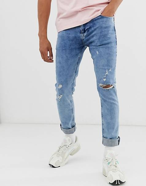 ASOS DESIGN skinny jeans in washed blue with knee rips