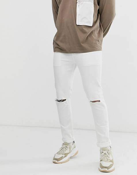 ASOS DESIGN skinny jeans with knee rips in white