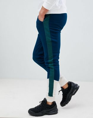 ASOS DESIGN skinny joggers with colour blocking and side stripes