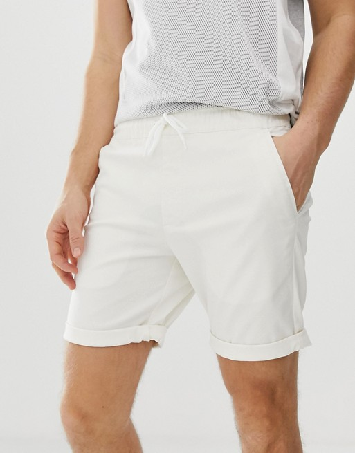 ASOS DESIGN slim chino shorts with elastic waist in off white