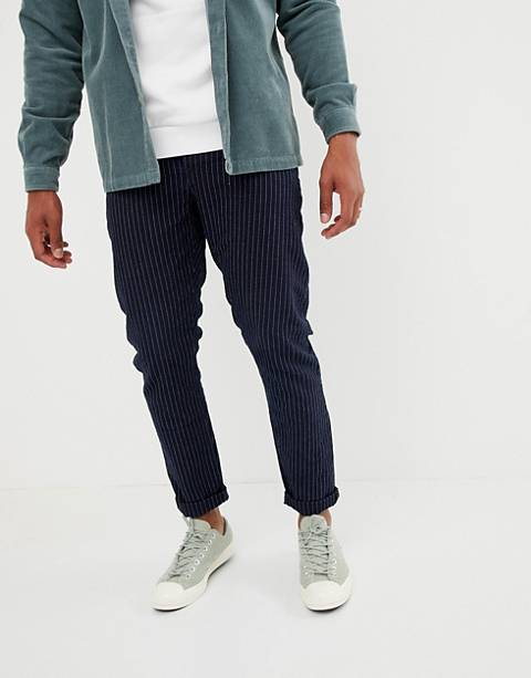 ASOS DESIGN slim jeans in indigo with stripe