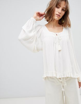 ASOS DESIGN smock long sleeve top with tassel ties in textured fabric