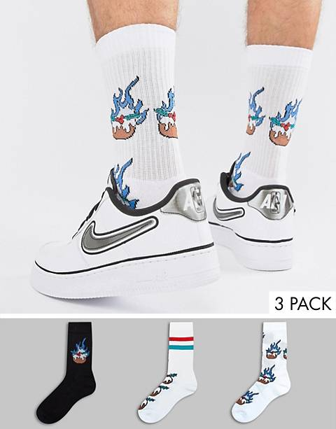 ASOS DESIGN sports style socks with flaming Holidays pud 3 pack