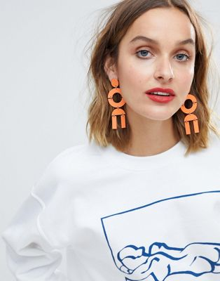 ASOS DESIGN statement earrings in geo shape design in orange