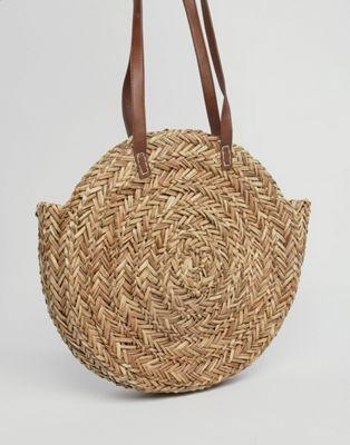 ASOS DESIGN straw circle bag with water based pu strap