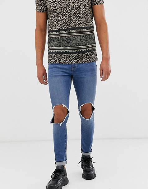 ASOS DESIGN super skinny jeans in mid wash blue with open knee rip