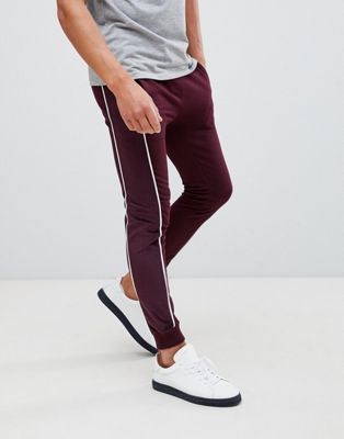 Image 1 of ASOS DESIGN super skinny joggers with velour side stripe and piping in burgundy