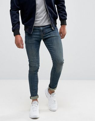 ASOS DESIGN - Superskinny jeans in donkerblauwe wassing