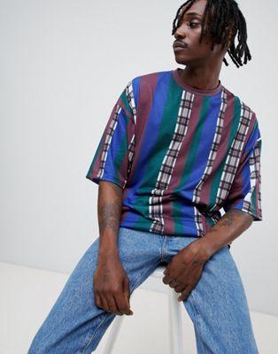ASOS DESIGN - T-shirt oversize a mezze maniche con motivo a righe e quadri