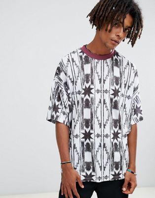Immagine 1 di ASOS DESIGN - T-shirt oversize con stampa azteca verticale e bordi a contrasto