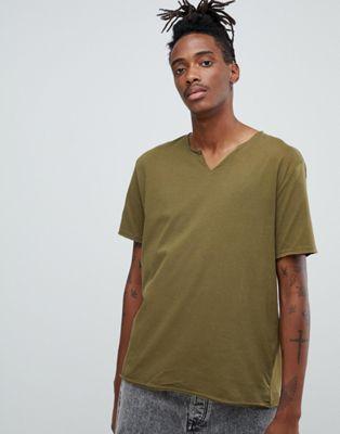 Immagine 1 di ASOS DESIGN - T-shirt verde comoda con scollo grezzo con intaglio
