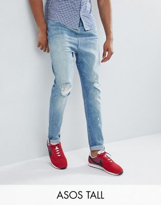 Image 1 of ASOS DESIGN Tall Drop Crotch Jeans In Mid Wash Blue With Rips