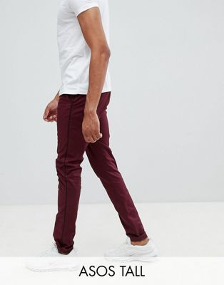 ASOS DESIGN Tall skinny trousers in burgundy with black side piping